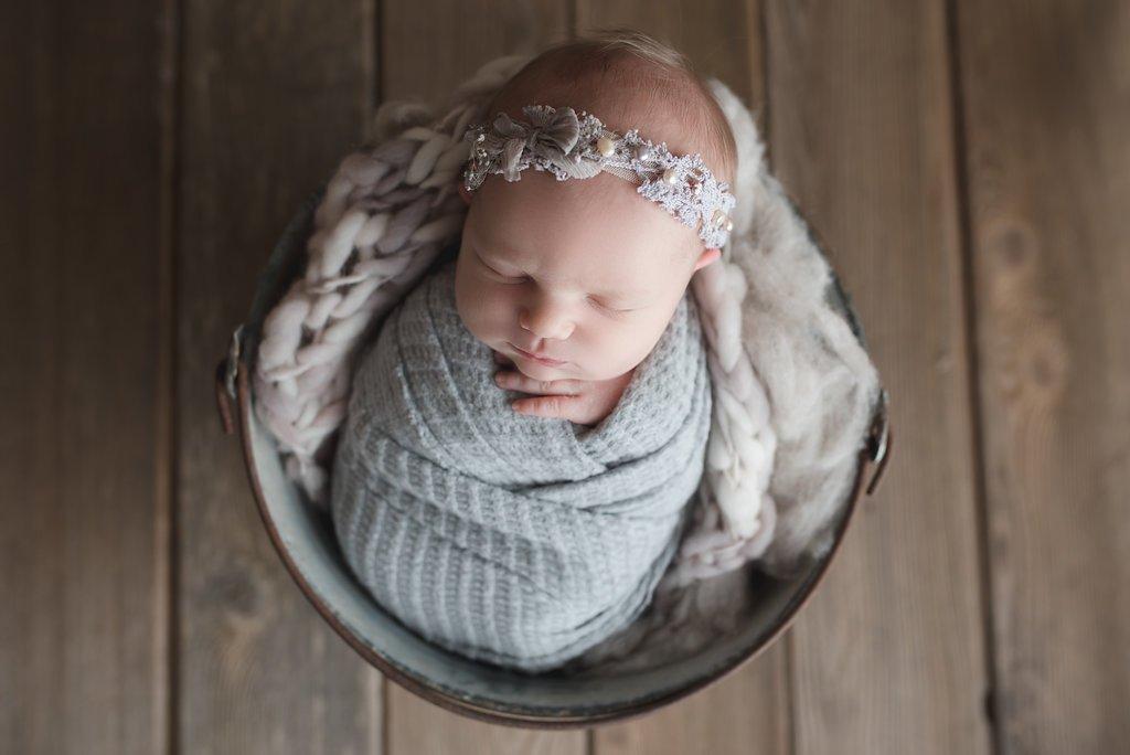 Seattle newborn photographer baby girl in a bucket newborn girl photographer newborn session ideas